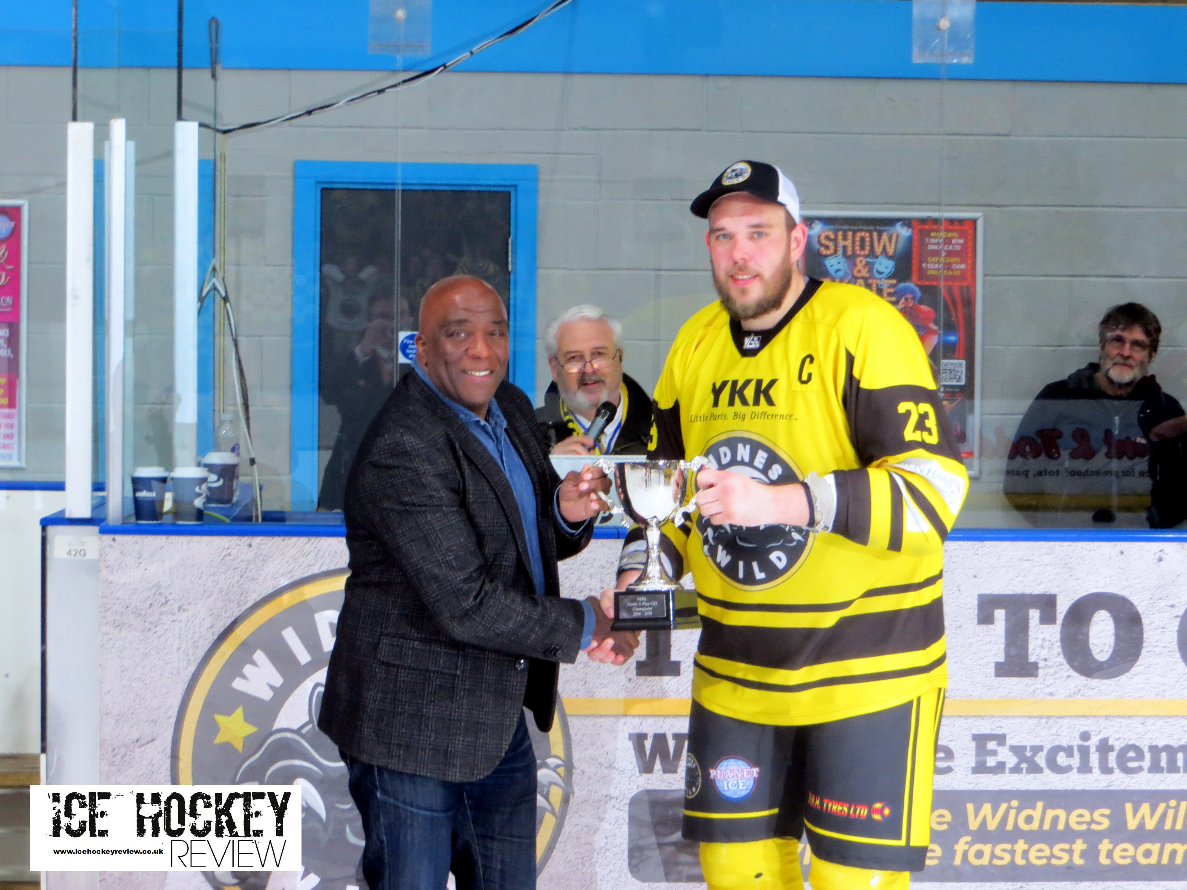 wild captain simon offord receives play off trophy with logo - YKK